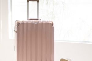 pink luggage and bag and hat for travel