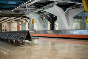 Empty conveyor luggage airport belt and sits